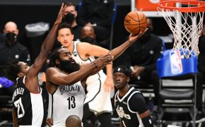 James Harden laying ball in