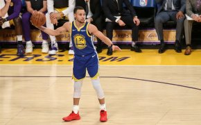 Steph Curry winding up to throw basketball