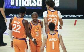 Phoenix Suns players at midcourt