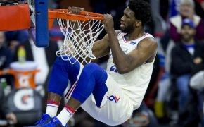 Joel Embiid dunk and hanging on the rim
