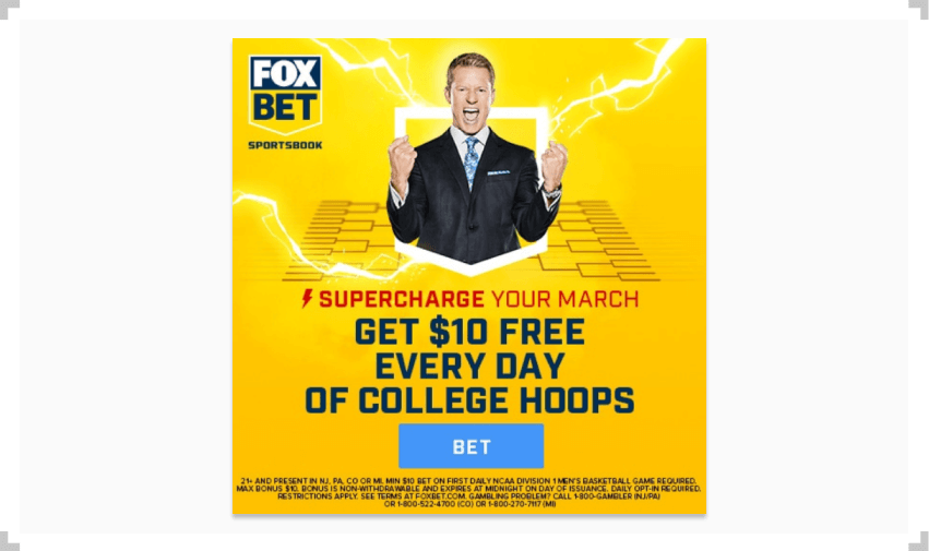 FOX Bet ad man in suit over March Madness bracket