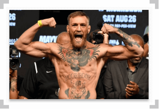 Conor McGregor flexing at a UFC weigh in