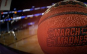 image of a basketball that says march madness on it
