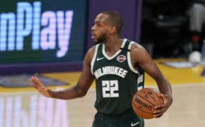 Khris Middleton holding ball on the court with hand out