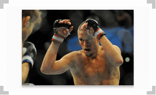 Nate Diaz hands raised during a fight