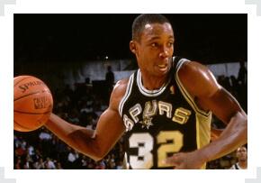 Sean Elliot San Antonio Spurs holding basketball one hand