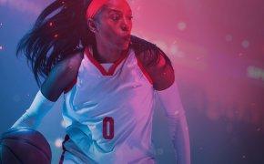 women's basketball player driving the ball