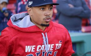 Mookie Betts jogging on the field at Fenway Park