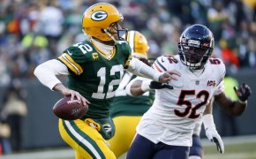 Aaron Rodgers chased by Khalil Mack