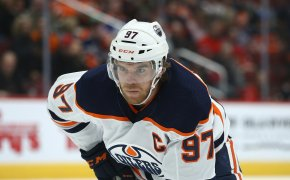 Edmonton Oilers center Conner McDavid watching the puck during an NHL game.