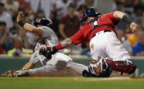Boston Red Sox's Christian Vazquez tries to tag Houston Astros' Michael Brantley