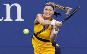 Petra Kvitova hitting a return shot during a tennis match.