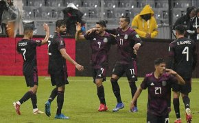 Mexican players celebrate goal