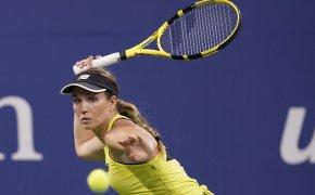 Danielle Collins hitting a return shot during a tennis match.
