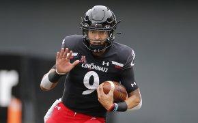 Desmond Ridder running with football