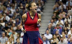 Aryna Sabalenka reacting after winning a point during a tennis match.