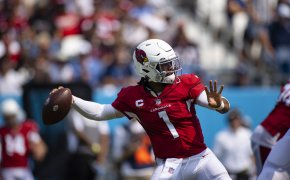 Kyler Murray looking to throw a pass during an NFL football game.