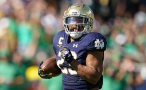 Notre Dame running back Kyren Williams running in for a touchdown during a football game.