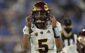Jayden Daniels pointing to helmet