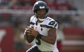 Russell Wilson running with football