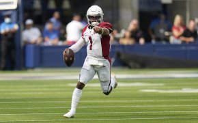 Kyler Murray running and pointing