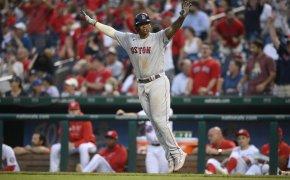 Rafael Devers celebrates a go-ahead home run