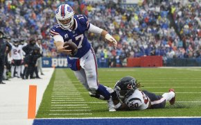 Josh Allen reaching for endzone while being tackled