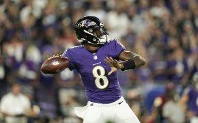 Baltimore Ravens quarterback Lamar Jackson throwing a pass during an NFL football game.