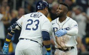 Tampa Bay Rays' Randy Arozarena celebaring a home run with teammate Nelson Cruz
