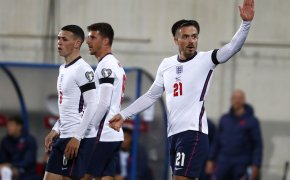 England's Jack Grealish celebrating with teammates after scoring a goal during a World Cup qualifying soccer match.