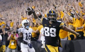 Iowa wide receiver Nico Ragaini reacting after scoring a touchdown during a college football game.