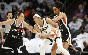 Candace Parker is pressured by Diana Taurasi