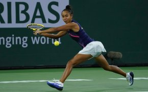 Leylah Fernandez hitting a return shot during a tennis match.