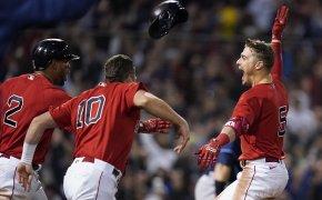 Boston Red Sox Enrique Hernandez celebrating with teammates