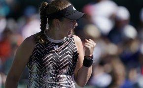 Jelena Ostapenko celebrating after winning a tennis match.