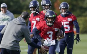 Russell Wilson running with football in left hand