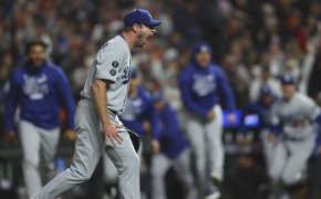 Los Angeles Dodgers pitcher Max Scherzer screaming jubilantly