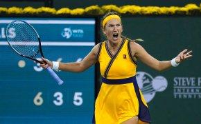 Victoria Azarenka celebrating after winning a tennis match.