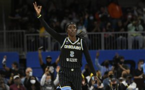 Kahleah Copper holds up three fingers after making shot