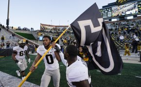 Purdue wide receiver Milton Wright celebrating after an NCAA college football game win.