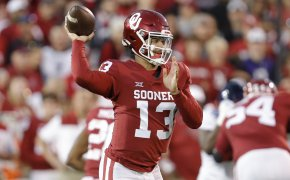 Oklahoma quarterback Caleb Williams looking to throw the ball during a college football game.