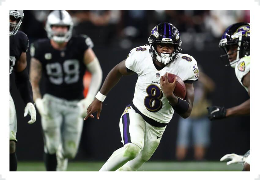 Lamar Jackson running with football