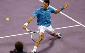 Novak Djokovic hitting a volley