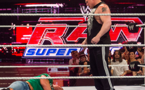 Brock Lesnar standing over John Cena back in 2012
