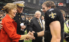 Drew Brees shaking hands with a military family