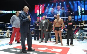 Fedor Emlianenko in the ring with Vladimir Putin after a fight