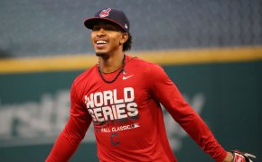 Indians SS Francisco Lindor smiling on the field during warmup.