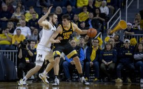 Iowa's Luka Garza backing down Michigan's Austin Davis