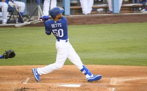 Los Angeles Dodgers right fielder Mookie Betts swings at a pitch