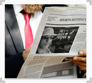 photo of a man reading the anthony best interview in a newspaper